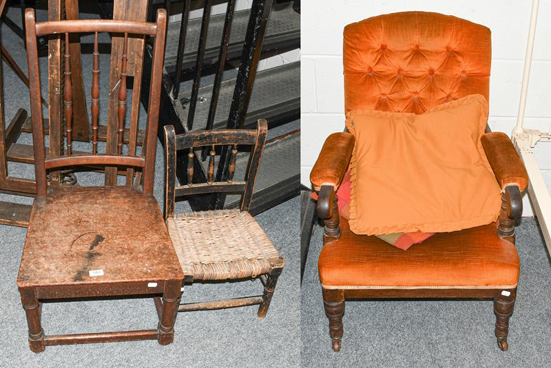 A Victorian mahogany upholstered fireside armchair, a mahogany country chair and a child's rush