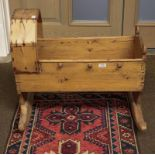 A Victorian pine crib, 59cm by 70cm by 64cm