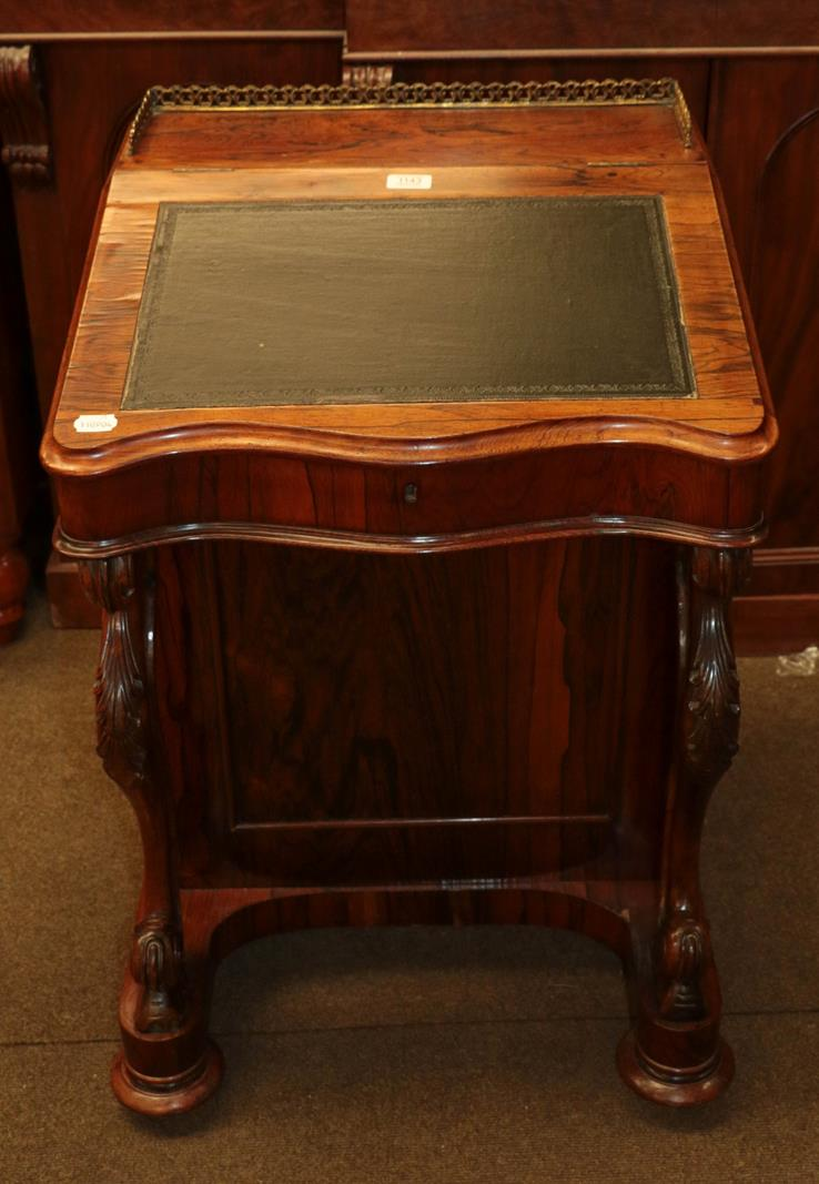 A Victorian rosewood davenport, 56cm by 56cm by 83cm