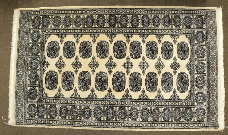 A Kashmiri 'Bukhara' Rug, the ivory field with columns of guls enclosed by narrow borders, largest - Image 3 of 3