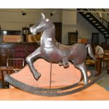 A decorative metal rocking horse, 90cm long by 72cm high to the tip of the ears