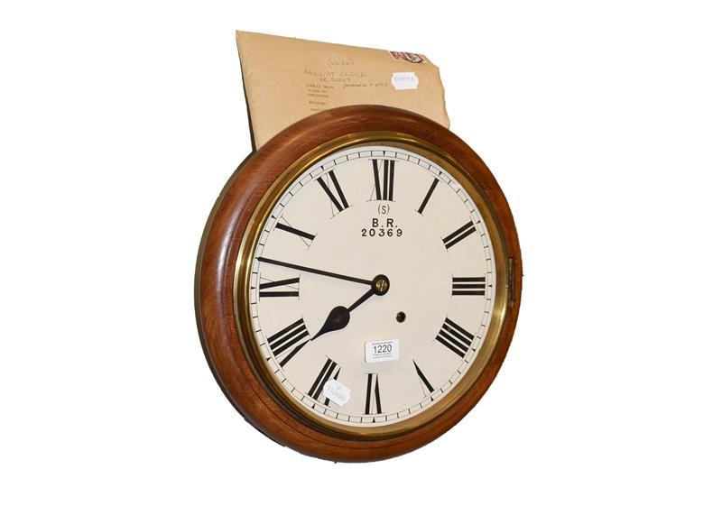 A 19th century eight day railway wall mounting timepiece in mahogany case, with painted 12'' dial