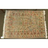 Hereke silk prayer rug, the ivory field with issuing flowers beneath the Mihrab framed by upper