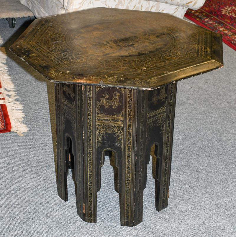 A 19th century Indian lacquered octagonal occasional table, incised to the top with Hindi figured in