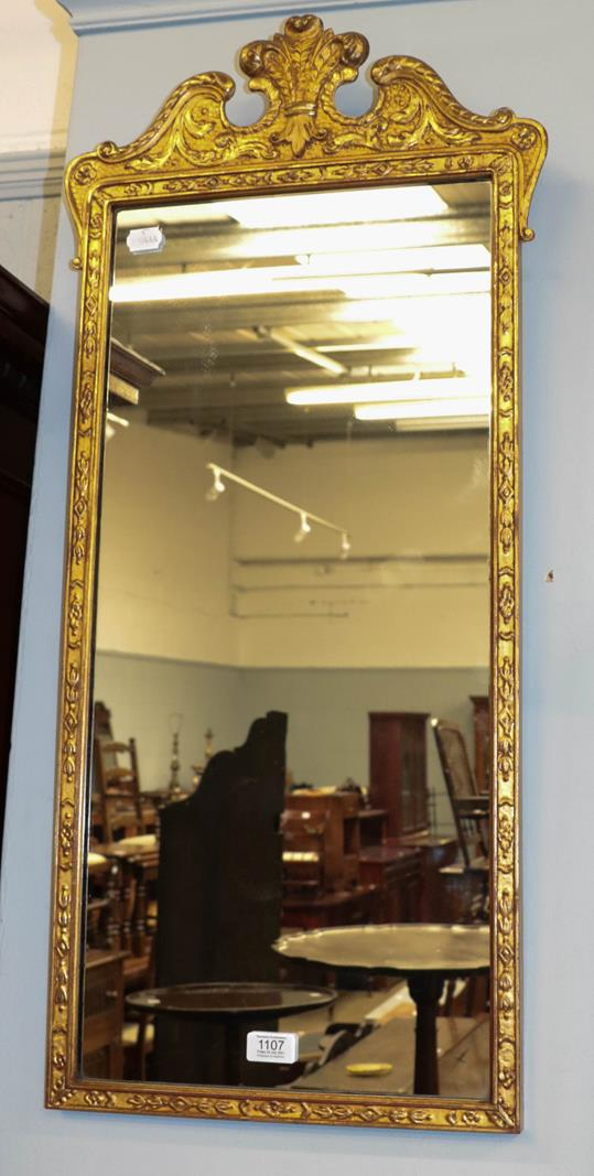 A giltwood and gesso wall mirror with swan neck pediment and Prince of Wales feathers motif, 40cm by