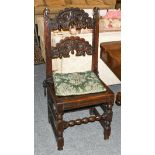 A 17th century oak Derbyshire chair of pegged construction