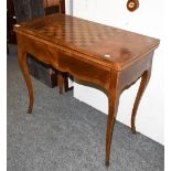 A 19th century inlaid fold-over tea table, the rectangular top with checkered games board, 85cm by