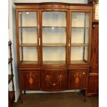 An Edwardian inlaid mahogany bow front display cabinet, 137cm by 40cm by 188cm