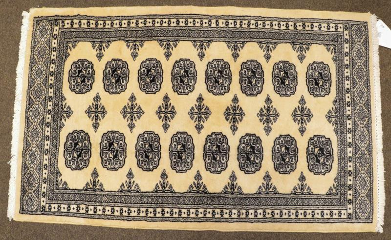 A Kashmiri 'Bukhara' Rug, the ivory field with columns of guls enclosed by narrow borders, largest - Image 2 of 3