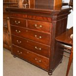 A Regency mahogany four-height chest of drawers with cantered corners with reeded mouldings and