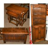 A Mellowcraft oak nest of three occasional tables, blanket box and corner cupboard (3)
