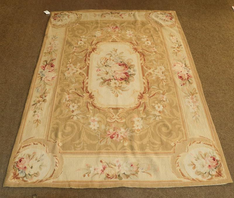 Chinese neddlepoint rug of Aubusson design the field with a panel of naturalistic roses enclosed