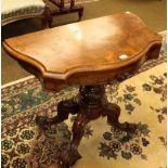 A Victorian walnut veneered card table, 91cm by 45cm by 74cm