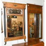 A Regency style pier glass with verre eglomise panel and ebonised supports, 67cm by 113cm together