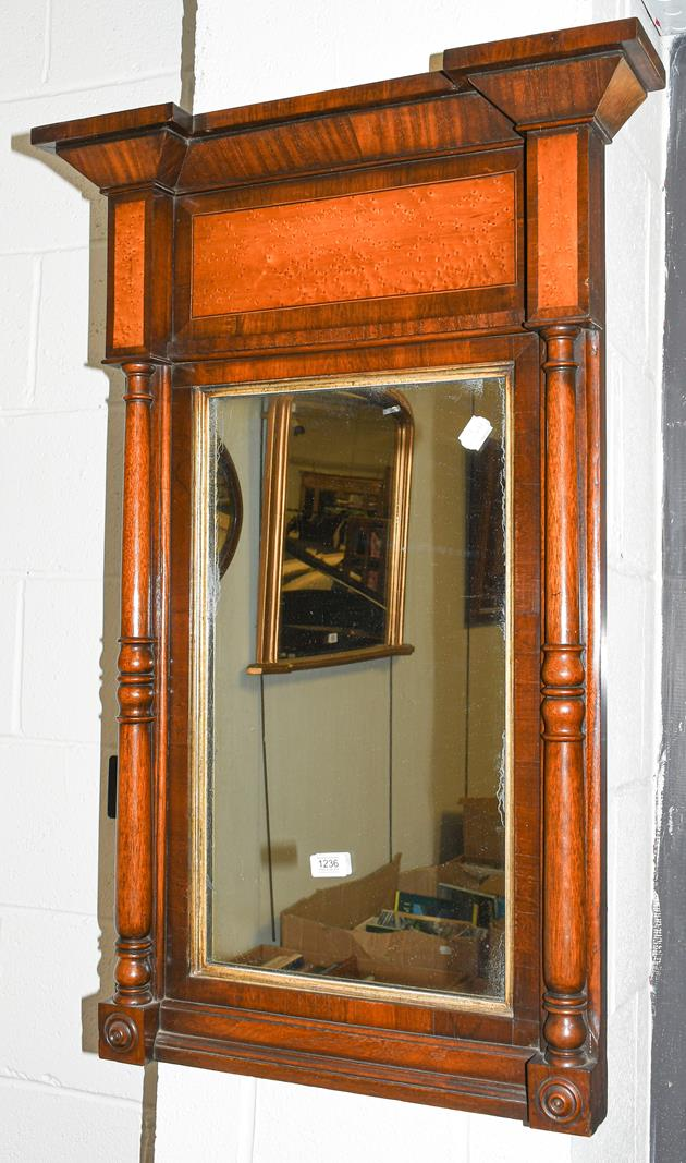 A 19th century mahogany pier glass with birds eye maple panels and turned supports, 62cm by 95cm