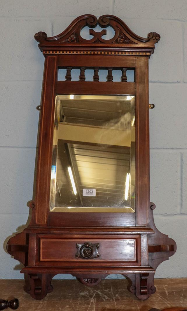 A Victorian mahogany hall mirror with swan neck pediment, strung inlay and incorporating a glove