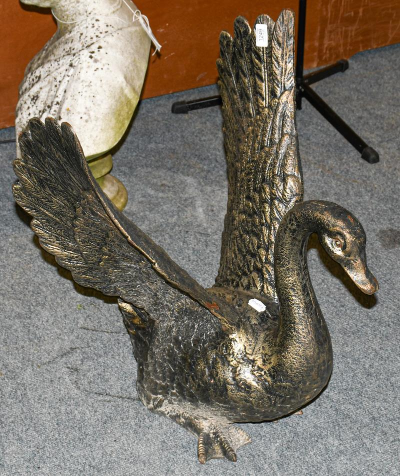 A cast bronzed metal sculpture of a swan with outstretched wings, 67cm high