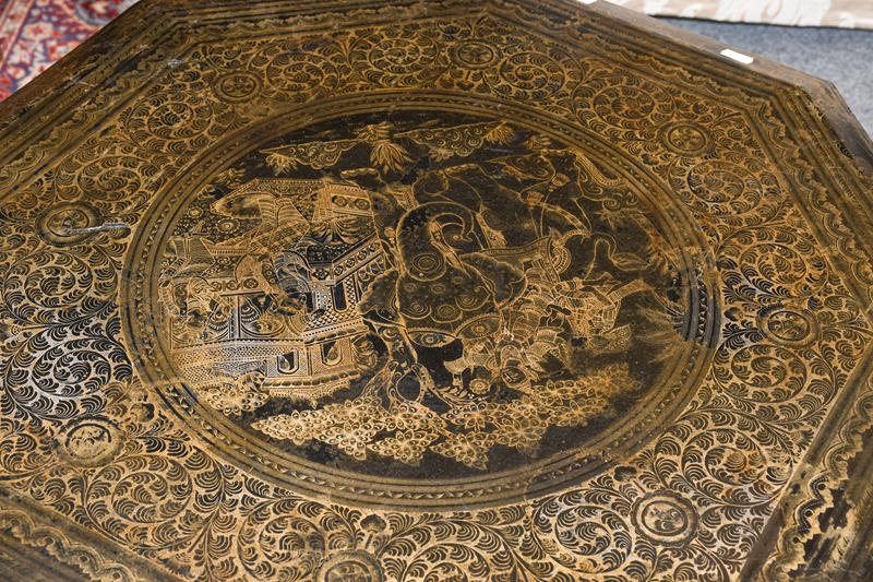 A 19th century Indian lacquered octagonal occasional table, incised to the top with Hindi figured in - Image 2 of 2