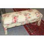 A bench seat with loose cushion upholstered with Colefax & Fowler fabric