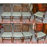 A set of eight George III mahogany stick back dining chairs, including a pair of carver armchairs