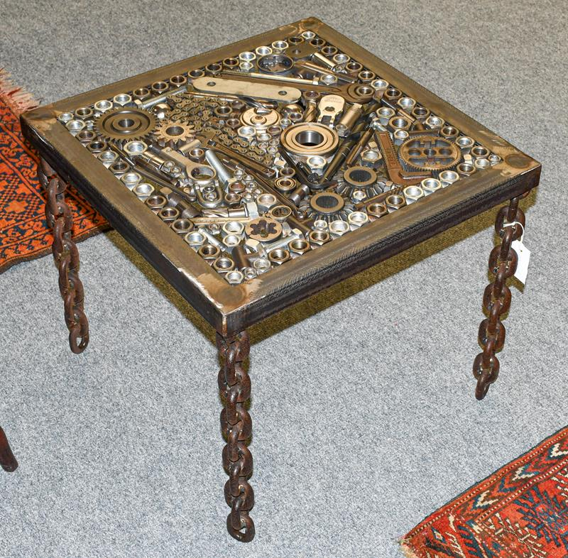 A Steampunk Industrial metal lamp table, constructed using various industrial sprockets, gears,