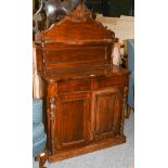 An early 20th century mahogany chiffonier of serpentine form, with turned supports, 87cm by 40cm