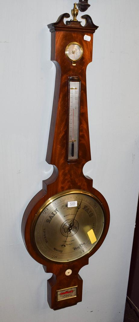 A mahogany 12'' dial wheel barometer with silvered dial signed Williamson, Royal Exchange London,