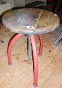 Industrial machinist's swivel stool with red painted metal tripod legs