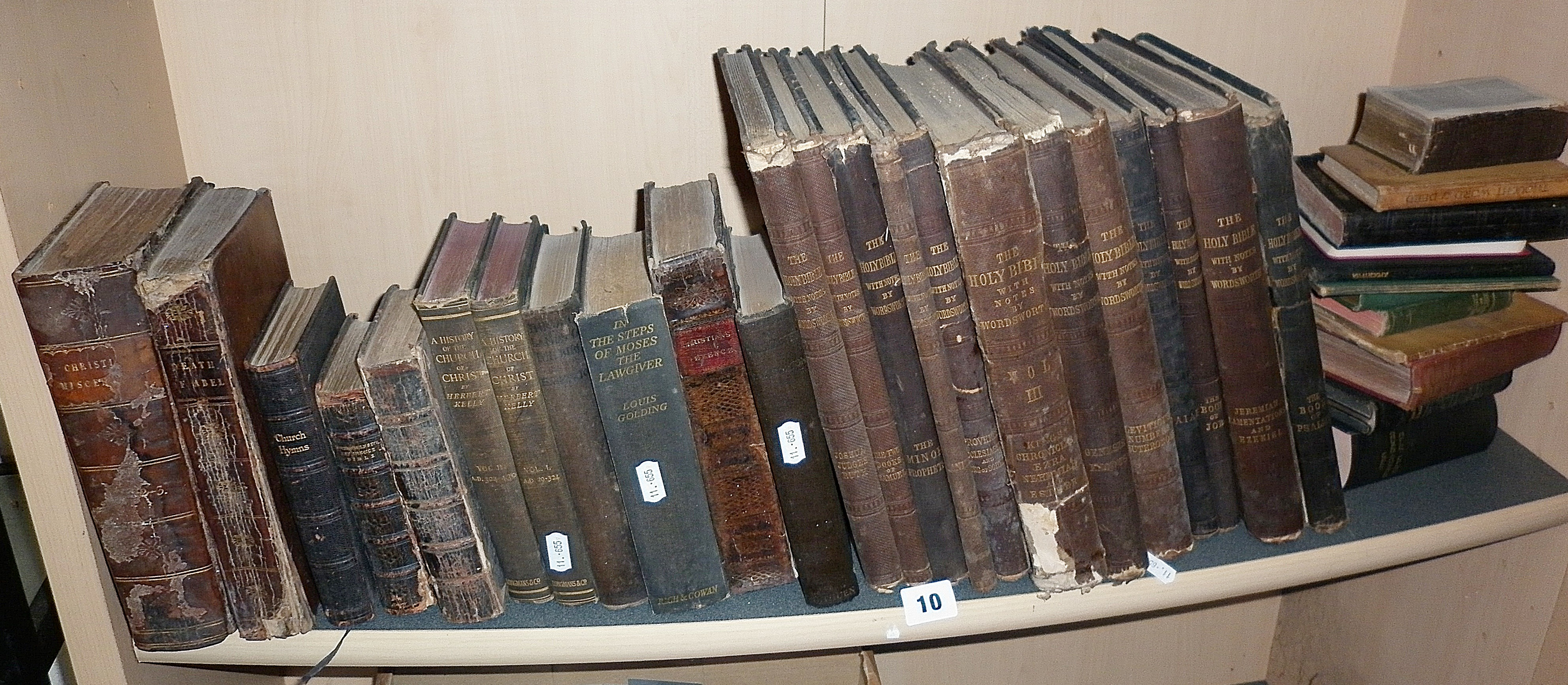 Twelve vols of 1876 'The Holy Bible' with notes by Wordsworth and assorted similar religious books