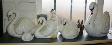 Large Dartmouth pottery swan with five smaller similar and three other items