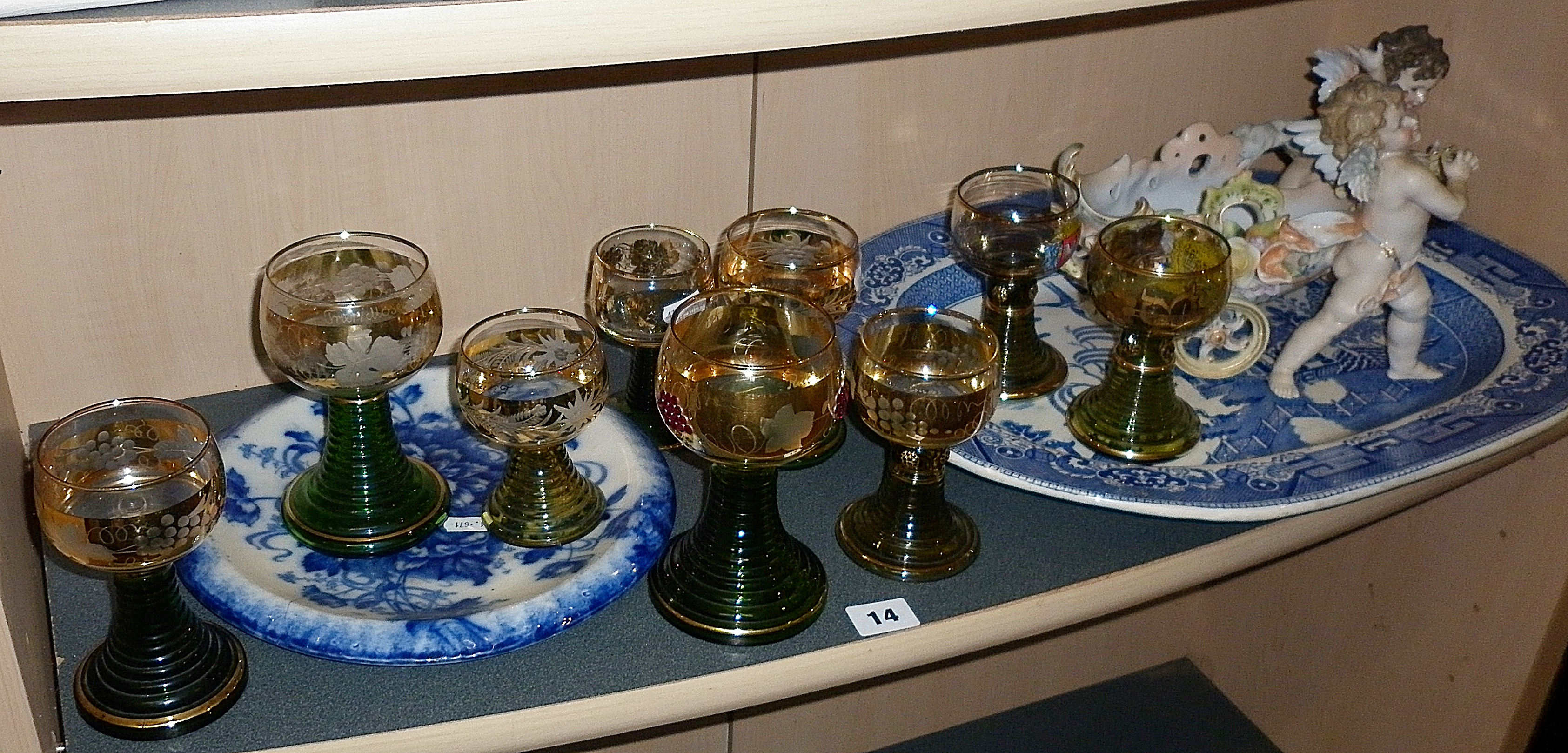 Nine assorted German Hock glasses, having gold vine leaf decoration and green stepped stems, a