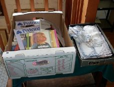 Box of knitting and crochet pattern books and assorted pieces of embroidered cotton