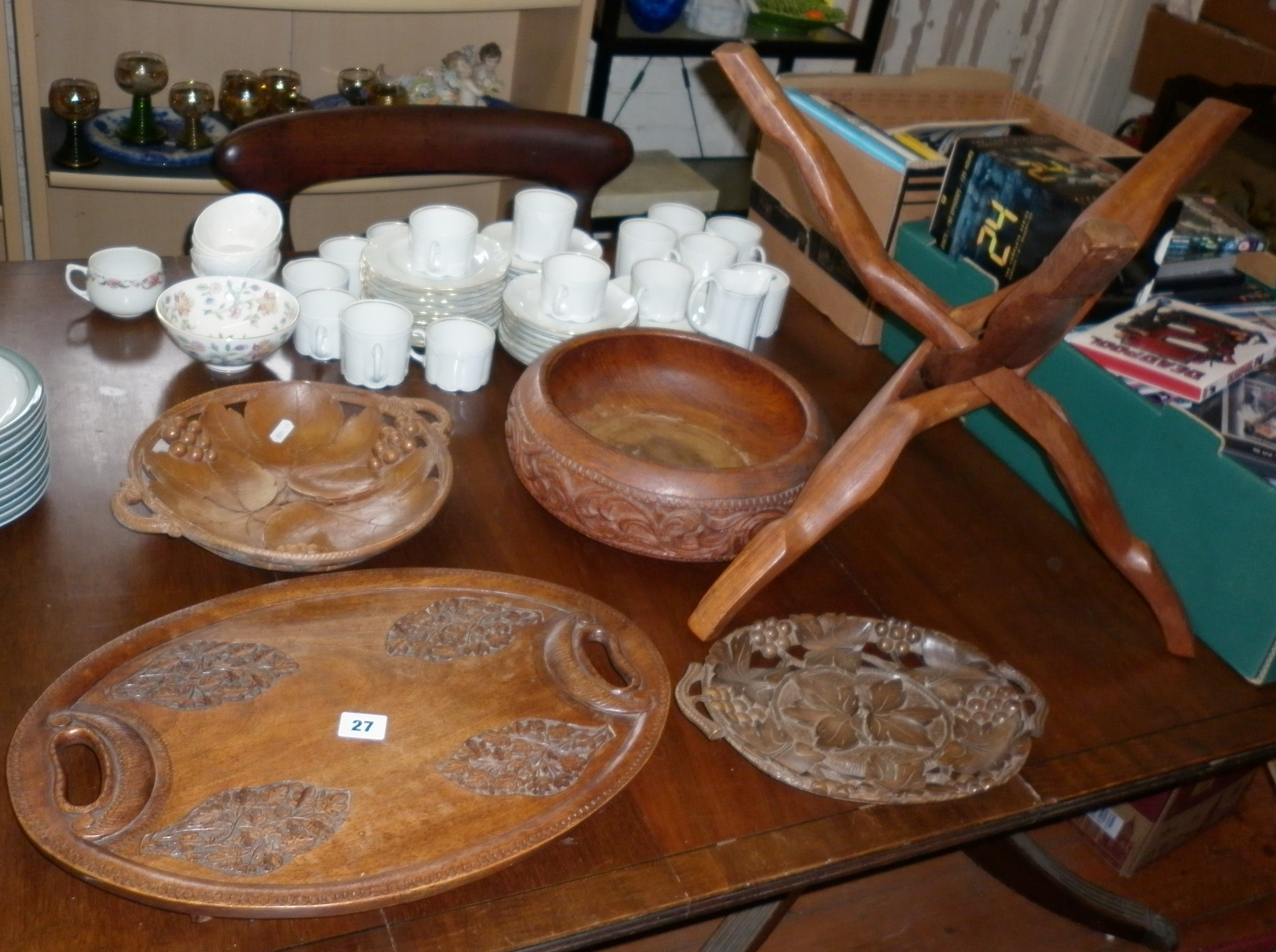 Three carved wooden fruit bowls, an oval carved wooden tray and a carved wood intertwined folding