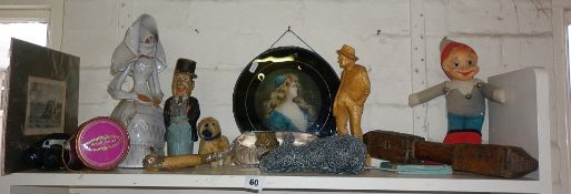 Shelf of assorted items including humorous painted carved figure etc.