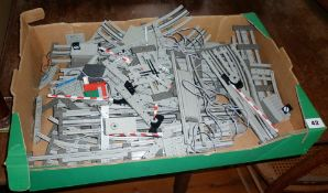 Large box of Lego train track and accessories