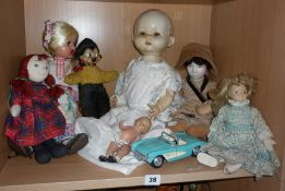 Group of seven assorted old dolls and a Die-cast Chevrolet Corvette car
