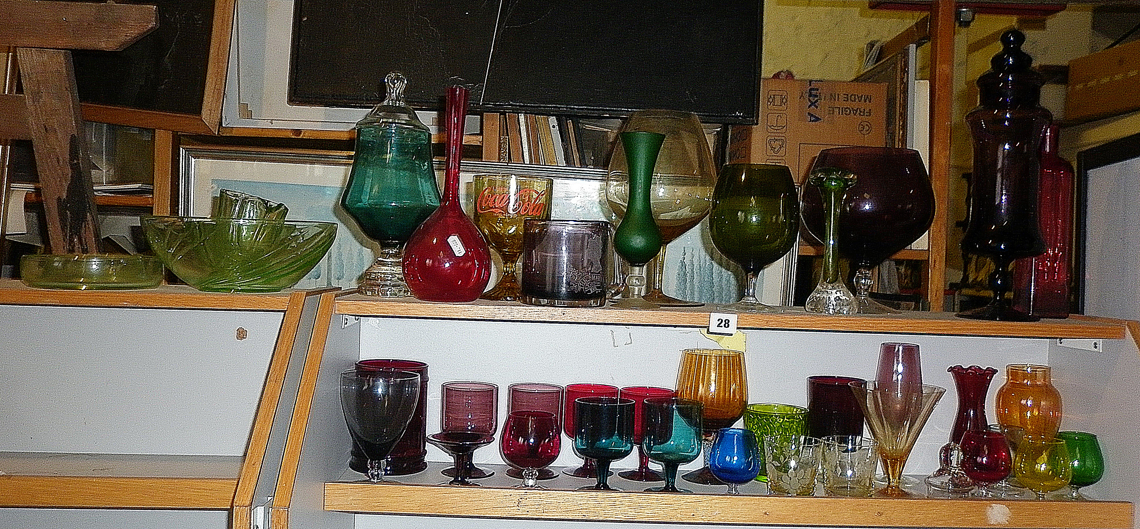 Two shelves of assorted coloured glassware (35 pieces)