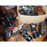 Collection of assorted cameras and binoculars, inc. Pentax, Canon, Kodak, etc.