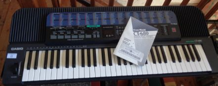 A Casio CT-680 electronic keyboard in working order with cover and box