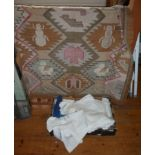 Box of linen and dhurry rug