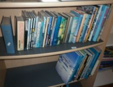 Two shelves of books on aviation