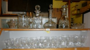 Three various cut glass decanters, five sets of assorted wine glasses and other glassware