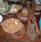 Three carved wooden fruit bowls, an oval carved tray and a carved wood intertwined folding stand