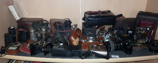 Collection of assorted cameras and binoculars