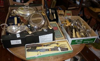 Two boxes of silver plated cutlery, inc. entree dishes, carving set, fish servers, etc.