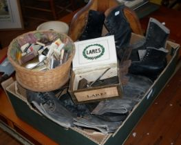 Assorted pairs of Victorian ice skating boots, two hair clippers and a quantity of match books