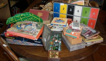 "Assorted board games, children's books, Hornby ""OO"" 3 rail track and a tin of marbles"