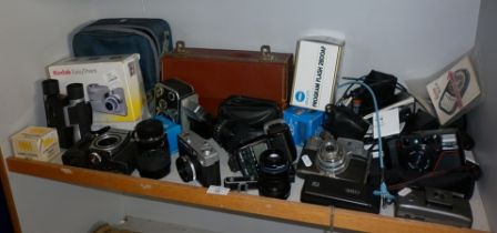 Shelf of assorted cameras and accessories