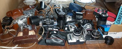 Collection of assorted cameras, lenses and camera bodies