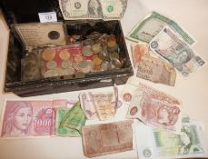 Good quantity of old coins and banknotes in a metal cash box